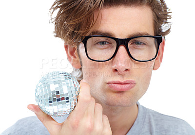 Buy stock photo Handsome young man pouting and holding a small disco ball