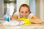 Smiling relaxed housewife taking a break from household chores