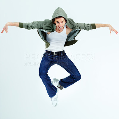 Buy stock photo Portrait of a young man jumping up and posing while in the air