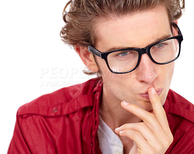 Buy stock photo Handsome young man wearing spectacles looking contemplative