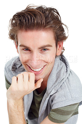 Buy stock photo Handsome young man posing with his chin in his hand and smiling
