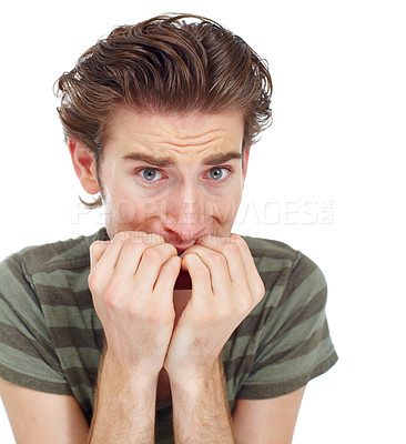 Buy stock photo Nervous young man chewing his nails - portrait