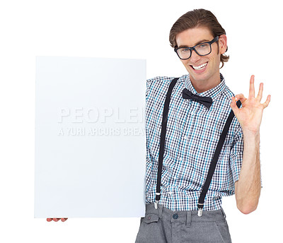 Buy stock photo Portrait of a young man holding a blank sign and showing you the a-okay sign