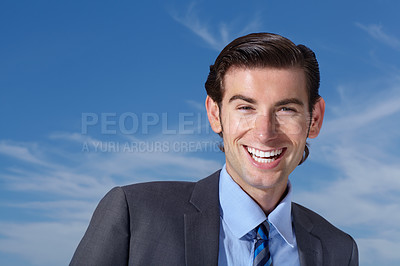 Buy stock photo Portrait of an enthusiastic young businessman standing against a blue sky