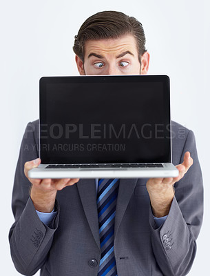 Buy stock photo A young businessman shocked at the deal going down for this laptop