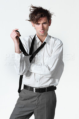 Buy stock photo A disheveled young businessman isolated on a white background