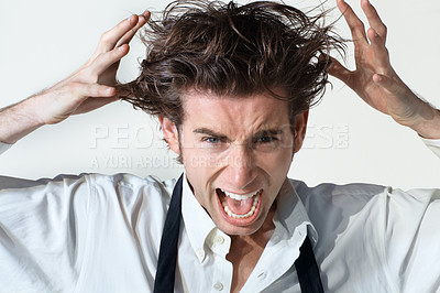 Buy stock photo A disheveled businessman going crazy