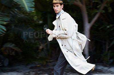 Buy stock photo Sneaky detective running away after snooping for clues