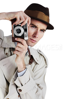 Buy stock photo Reporter taking a photo with a retro camera against a white background while looking away