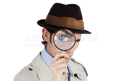 Buy stock photo Curious private investigator looking through a magnifying glass against a white background