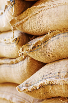 Buy stock photo Shot of burlap sacks filled with beans waiting for export