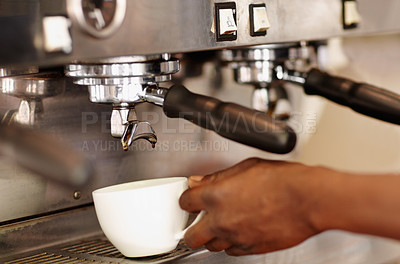 Buy stock photo Cropped shot of a barista preparing coffee
