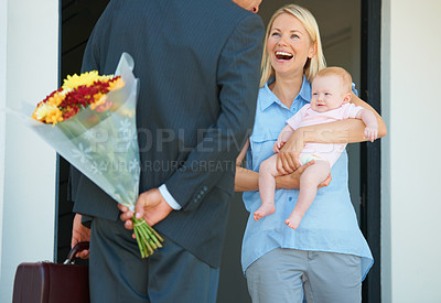 Buy stock photo Cropped shot of a man surprising his wife with flowers