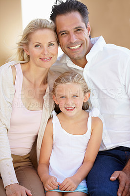 Buy stock photo Two delighted parents sitting with their adorable daughter