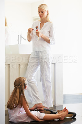 Buy stock photo Little girl watching her mother get ready