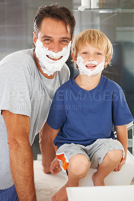 Buy stock photo A young boy and his father both with shaving cream on their faces