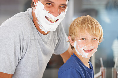Buy stock photo A young boy and his father with faces full of shaving cream