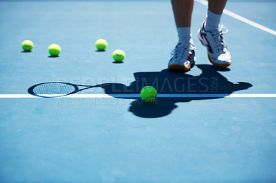 Buy stock photo Shot of a man unidentified man standing on a tennis court