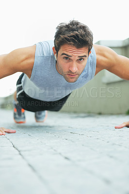Buy stock photo Fit young man doing push-ups - copyspace