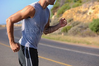 Buy stock photo Cropped image of a young man jogging - copyspace