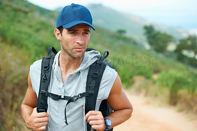 Buy stock photo Young hiker wearing a backpack looking sideways