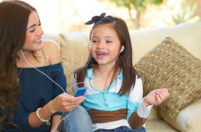 Buy stock photo Cute little girl listening to music with her mother
