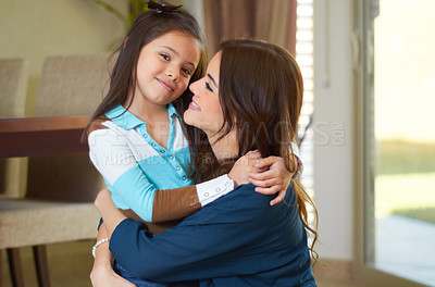 Buy stock photo Two sisters hugging each other while smiling