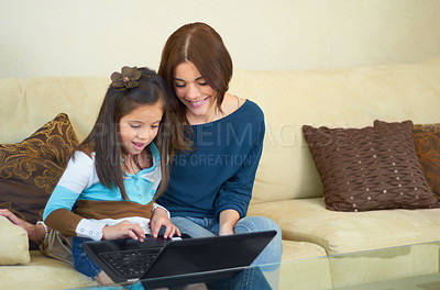 Buy stock photo Cute little girl learning how to use a laptop at home
