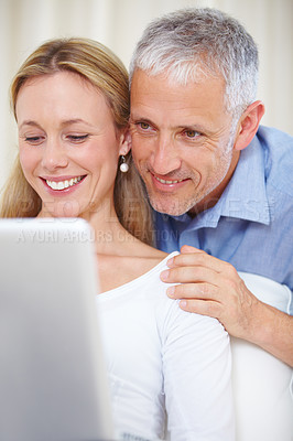 Buy stock photo A young married couple working on their laptop at home