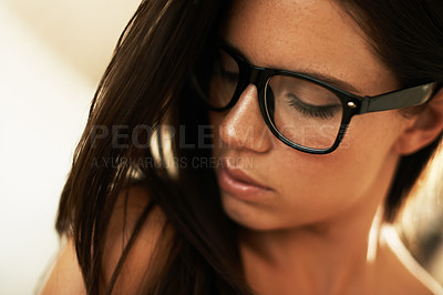 Buy stock photo Lovely young brunette looking downwards wearing glasses - closeup