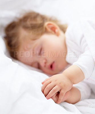 Buy stock photo A cute baby fast asleep on the bed