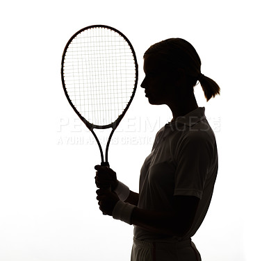 Buy stock photo Profile silhouette of a young woman holding her tennis racquet