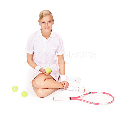 Buy stock photo Portrait of a beautiful young woman sitting on the floor with her tennis equipment