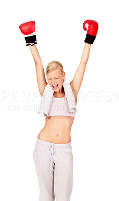 Buy stock photo Shot of a beautiful female boxer lifting her fist in to the air