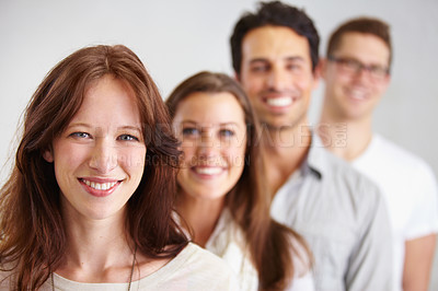 Buy stock photo Portrait of a group of young smiling business professionals standing in a row