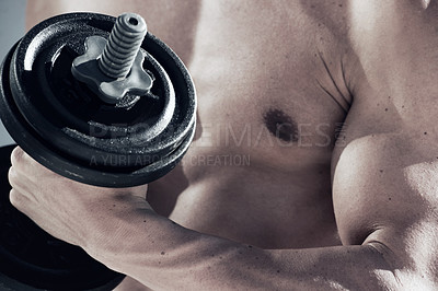 Buy stock photo A close up of a muscular man lifting weights