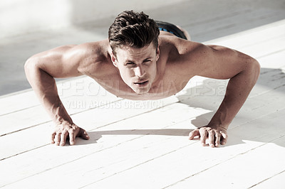 Buy stock photo A good looking male doing sit ups