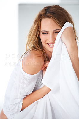 Buy stock photo A smiling woman hugging her sheet