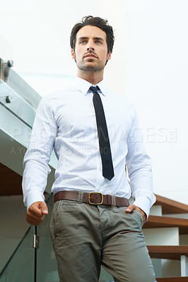 Buy stock photo A handsome man in a suit posing on a staircase