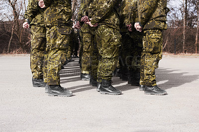 Buy stock photo A group of soldiers standing at attention