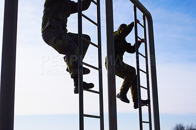 Buy stock photo Trainee pilots doing an obstacle course