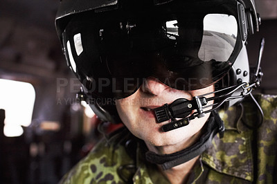 Buy stock photo A helicopter pilot wearing a helmet and smiling at the camera