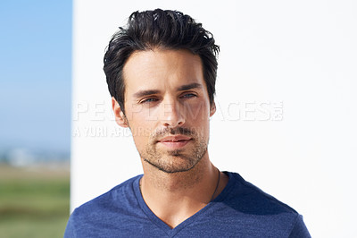 Buy stock photo Portrait of a handsome young man standing outside