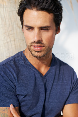 Buy stock photo A handsome young man looking away