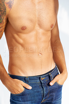 Buy stock photo Cropped image of a handsome young man's torso with a tattoo on his arm