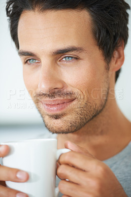 Buy stock photo Closeup of gorgeous young man looking tranquille and holding a cup of coffe