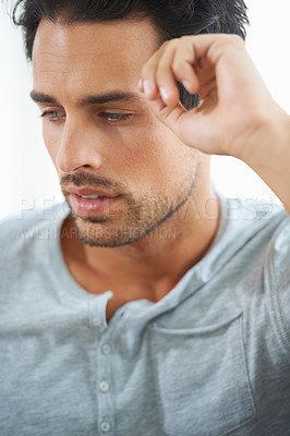 Buy stock photo A cropped shot gorgeous young man deep in thought against a white background