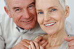 Closeup portrait of a smiling senior couple
