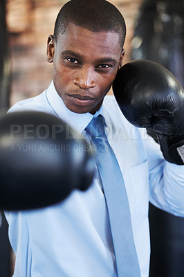 Buy stock photo A young african american boxer in a shirt and tie throwing a punch at you