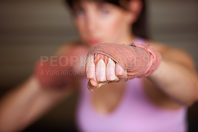 Buy stock photo A female boxer throwing a punch at the camera